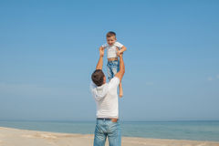 Father and his son having fun on the beach Royalty Free Stock Image