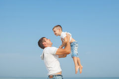 Father and his son having fun on the beach Royalty Free Stock Photos