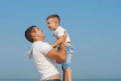 Father and his son having fun on the beach Royalty Free Stock Photography