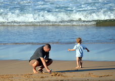 Father and his son having fun on the beach sunny outdoors background stock photos