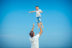 Father and his son having fun Royalty Free Stock Photography