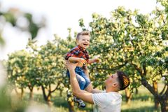 Father and his son having fun outside in summer hugging and laughing. Father taking care of his child. Father and his son having fun outside in summer hugging Royalty Free Stock Photos