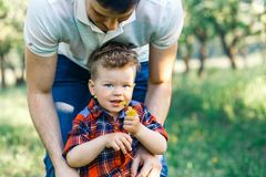 Father and his son having fun outside in summer hugging and laughing. Father taking care of his child. Father and his son having fun outside in summer hugging Royalty Free Stock Photo