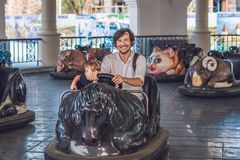 Father and his son having a ride in the bumper car at the amusem Stock Photography
