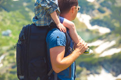 Father and his son hiking in mountains, Bulgaria Stock Images