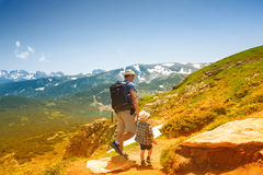 Father and his son hiking in mountains, Bulgaria Stock Photos