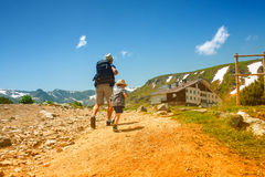 Father and his son hiking in mountains, Bulgaria Royalty Free Stock Image