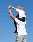 Father with his son on his back. Young father with his son on his back Stock Photography