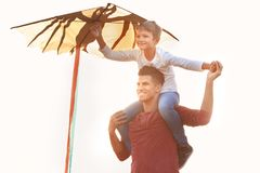 Father and his son with kite. Outdoors stock images