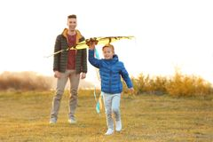 Father and his son with kite. Outdoors royalty free stock images