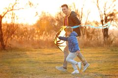 Father and his son with kite. Outdoors royalty free stock photography