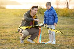 Father and his son with kite. Outdoors stock photography