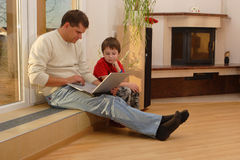 Father and his son with laptop Royalty Free Stock Image