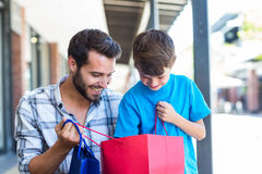 A father and his son looking into the bag Stock Photography