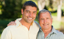 Father with his son looking at the camera Stock Image
