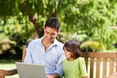 Father with his son looking at their laptop Royalty Free Stock Photo