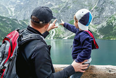 Father and his son near the Eye of the Sea lake. Poland. Royalty Free Stock Image
