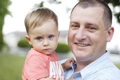 Father and his son. On outdoor stock image