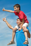 Father and his son outdoors Stock Photography