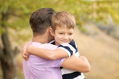 Father and his son outdoors. On sunny day royalty free stock photo