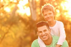 Father and his son outdoors. On sunny day stock photos