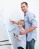 Father and his son painting a room Stock Image