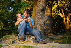 Father with his son in a park Royalty Free Stock Photo