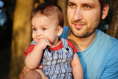 Father with his son in a park Stock Image