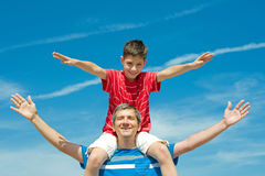 Father and his son play outdoors Stock Photos