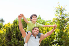 Father with his son playing in the garden Royalty Free Stock Photos