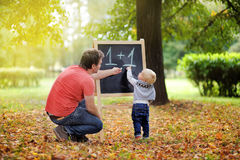 Father and his son practicing mathematics Stock Photo