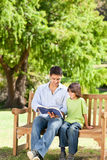 Father with his son reading a book. Young father with his son reading a book stock images