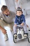 Father with his son riding retro car Stock Photos