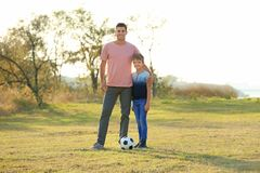 Father and his son with soccer ball. In countrye Royalty Free Stock Images