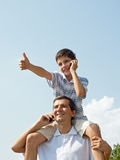 Father and his son are speaking over mobiles Stock Image