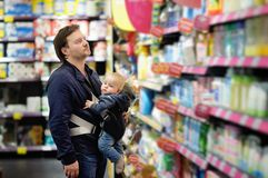 Father and his son at supermarket Stock Image