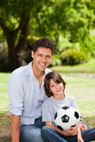 Father and his son with their ball in the park Stock Image