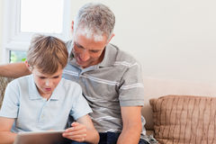 Father and his son using a tablet computer Royalty Free Stock Image