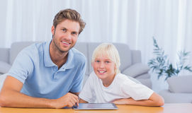 Father and his son using tablet Stock Images