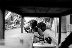 A father with his son. Is waiting for mothers who are shopping in traditional markets royalty free stock images