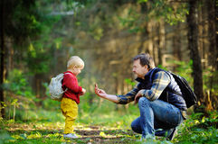 Father and his son walking during the hiking activities in forest Stock Photography