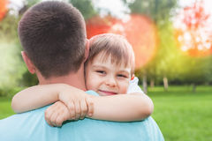 Father with his son walking outdoor. Child hugging dad. Family Love concept. Summer Stock Photos