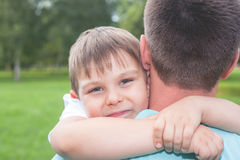 Father with his son walking outdoor. Child hugging dad. Family Love concept. Summer Stock Images