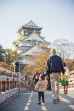 Father and his son walking on pathway to Osaka Castle Royalty Free Stock Photos