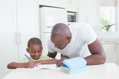 Father with his son working Stock Image