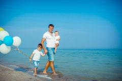 Father and his sons having fun on the beach Royalty Free Stock Photo