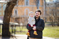 Father with his toddler son outdoors at the spring day Royalty Free Stock Image