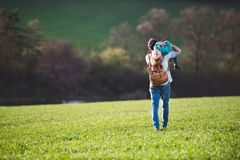 A father with his toddler son on a walk outside in spring nature. Royalty Free Stock Photography