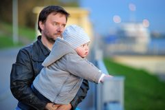 Father with his toddler son walking outdoors at the spring day Stock Photos
