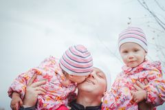 Father and his two daughters child girls have fun in the field stock photos